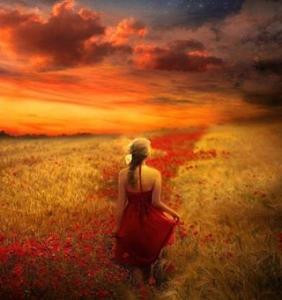 vrouw in rood in korenveld
